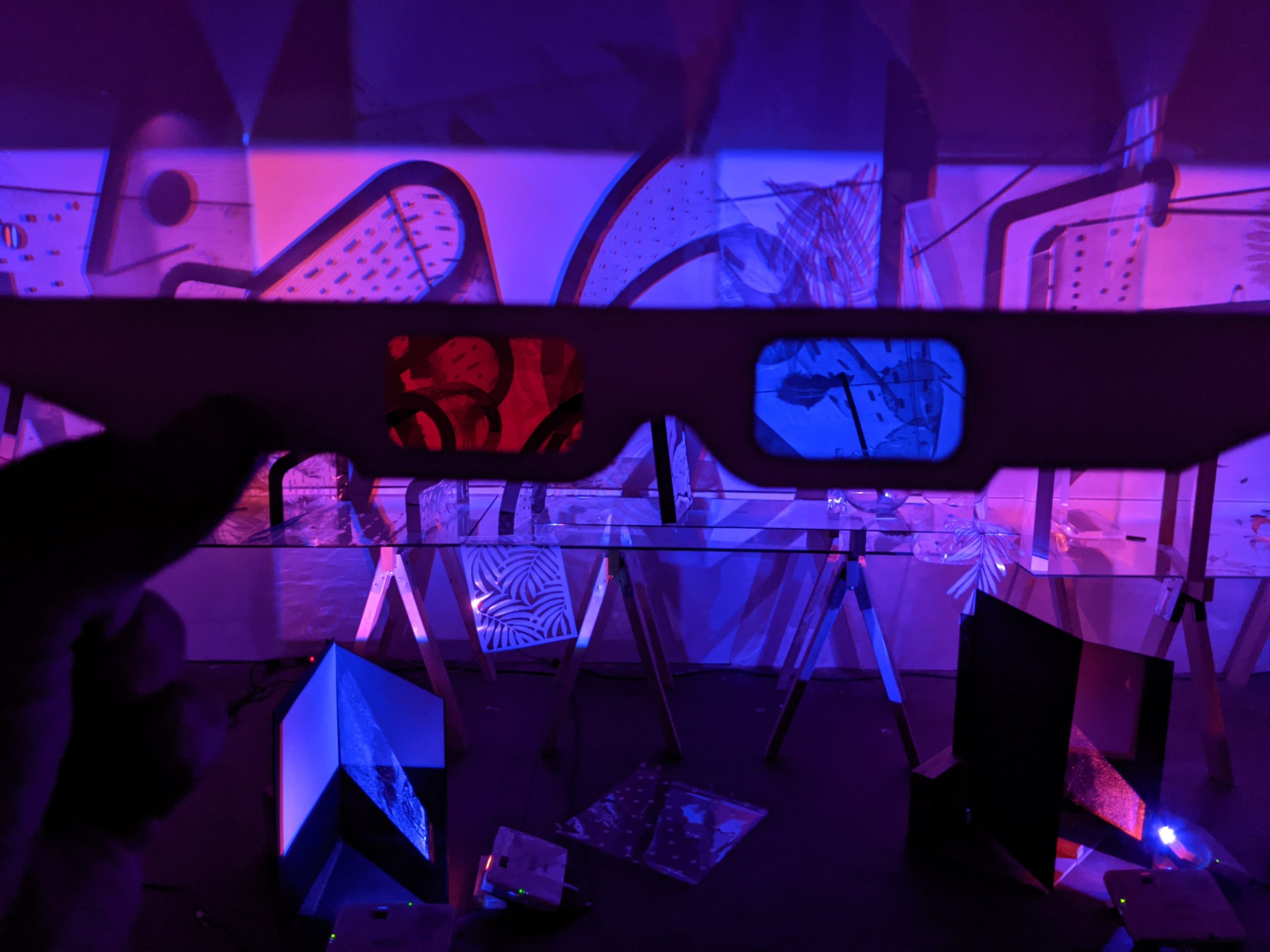 Blinn and Lambert NNAATTUURRAA MMOORRTTAA | A sprawling still life and a tableau of the objects' cast shadows, which, when viewed through 3D glasses, coalesce into a stereoscopic image.