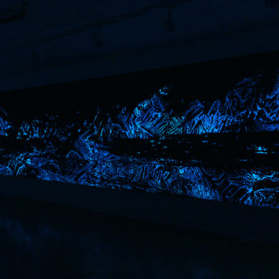 Shohei Katayama, Ancient Voices. Installation with Strontium Aluminate, Kopp Glass 40 filter, UV light, audio of deep-sea / surge glacier currents captured via goPro, sea sponges.