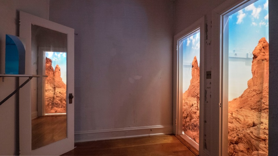 Installation with mirrors to create 3Dviewing of lightbox doorways