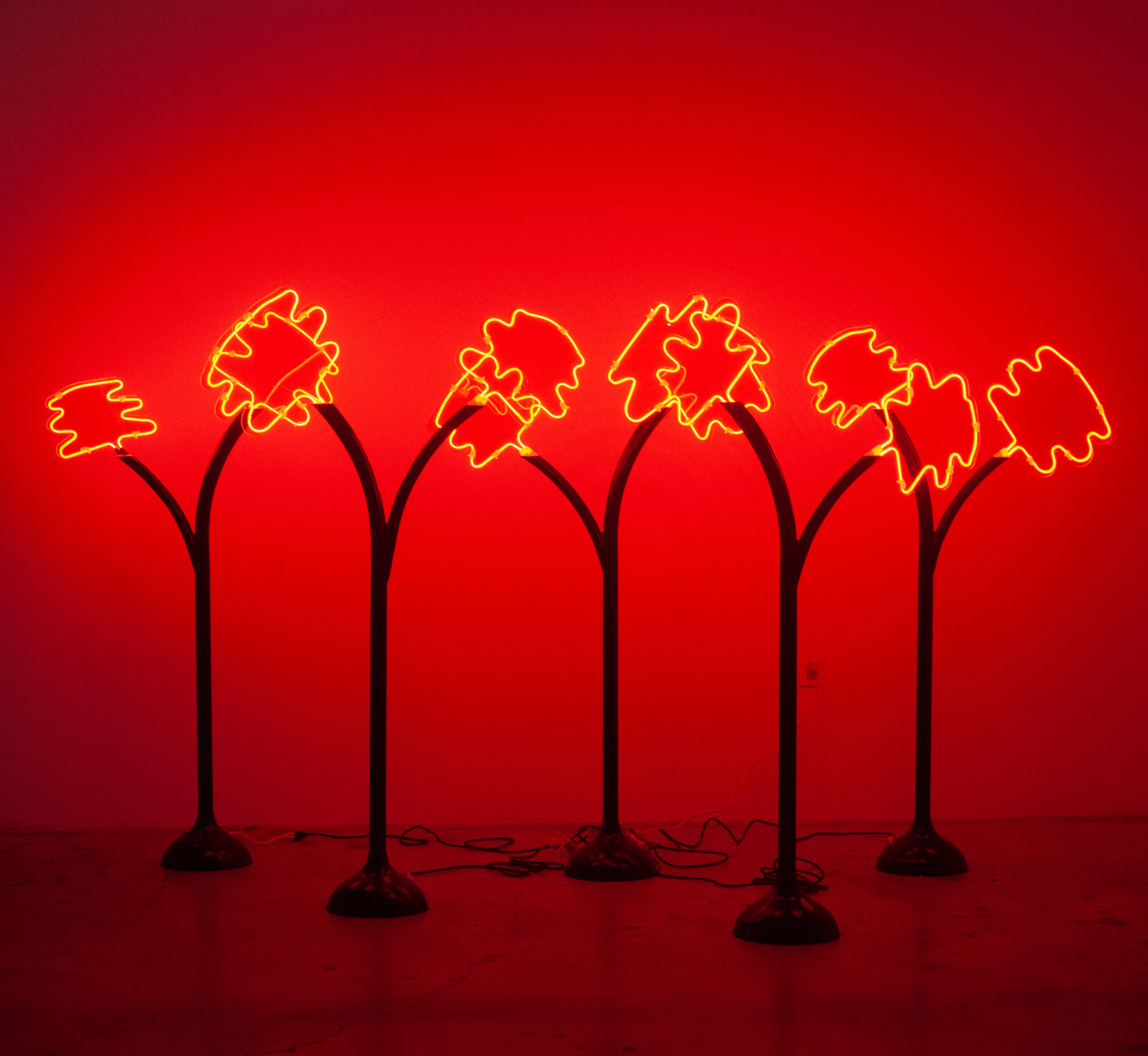 Emma Hendry, Forest Fire, installation with neon trees that eminate a flickering red light, EDGE OF LIGHT at the Plaxall Gallery