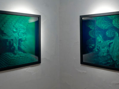 two holograms in the series CELESTIAL BALLERINA by Lana Blum | Installation view from the exhibition Holographic Embodiment at the HoloCenter on Governors Island | Each hologram shows a 3D scan of a dancer with digitally genetrated backgrounds they are installed on a corner.